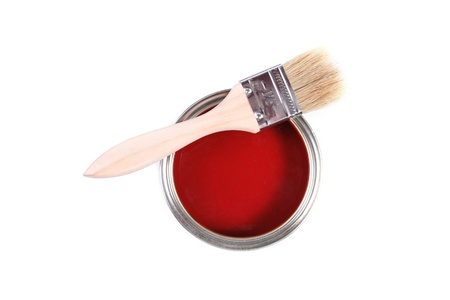 red paint can with brush isolated on a white background photo