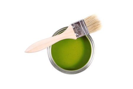 Green paint can with brush isolated on a white background photo
