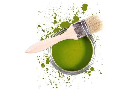 Green paint can with brush and color stains photo