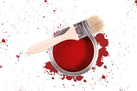 Red paint can with brush and color stains photo