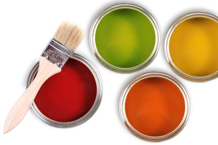 Colorful paint buckets with paintbrush photo