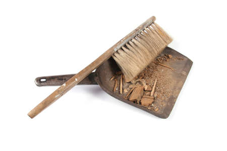 Brush and shovel with dust photo