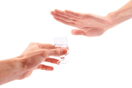 Hand reject a glass of alcohol photo