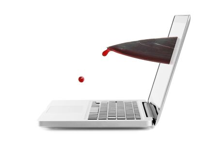 Internet violence concept - bloody knife out of laptop screen Stock Photo - 11350893