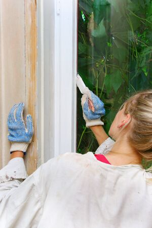 woman restores the window frame color Stock Photo - 11359756