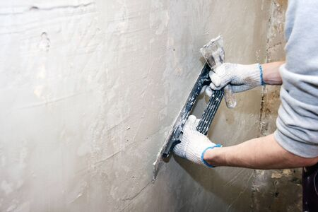 putty knives: repairing wall Stock Photo