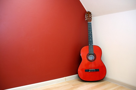 single rooms: Acoustic guitar in room corner