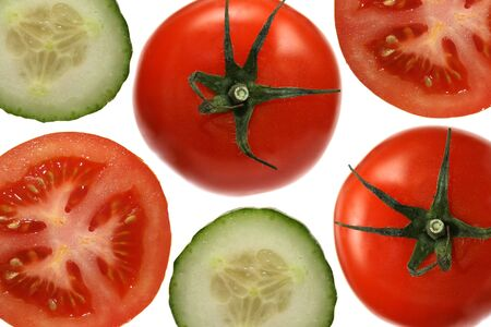 Tomatoes and cucumbers on white background photo