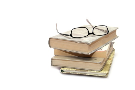 Books stack with eyeglasses photo
