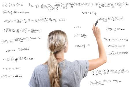 Woman writing mathematical equations photo