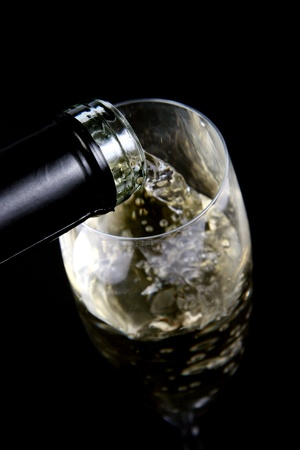 champagne pouring into a glass photo