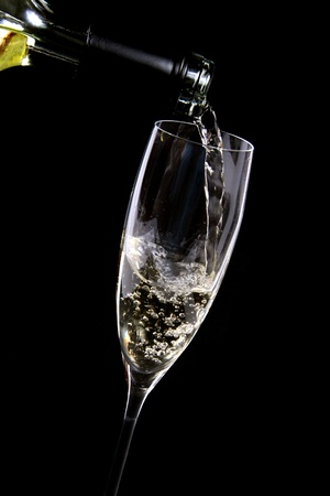 Wine being poured into a glass photo