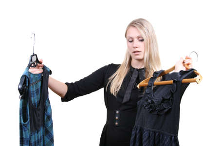 confused woman: Woman selecting clothes