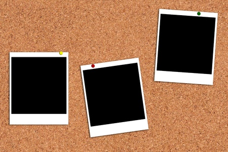 cork board: Photo frames on a cork board Stock Photo