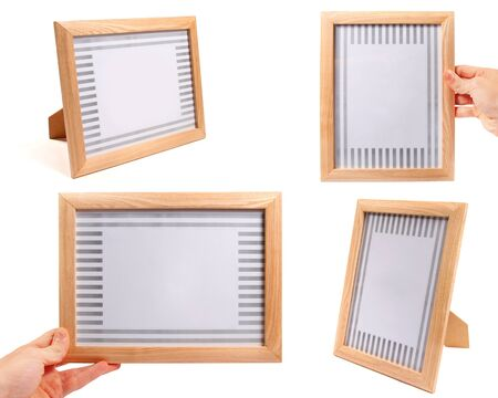 wooden picture frames isolated on white background photo