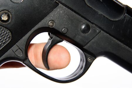 trigger: finger on trigger Stock Photo