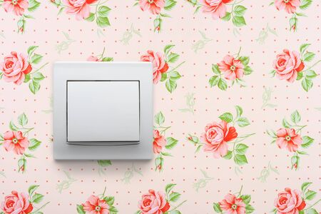 light switch on retro floral wallpaper photo