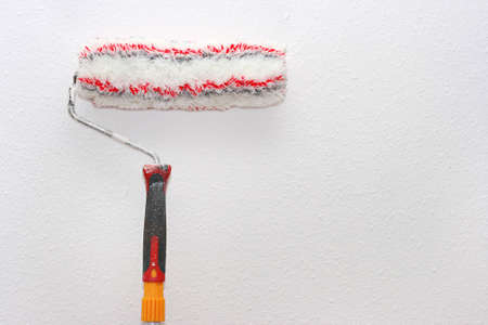 paint roller on the wall  photo