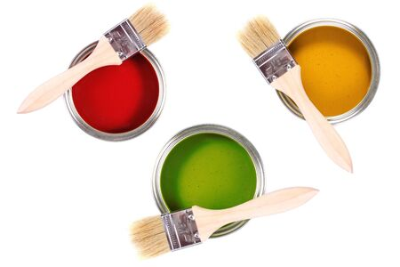 colorful paint cans with brushes isolated on white background photo