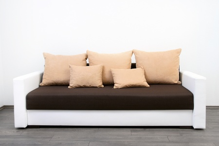 modern couch at white wall photo