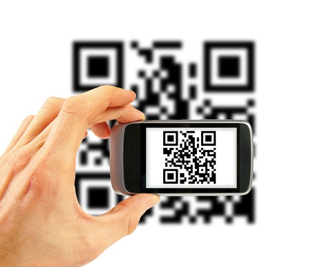 bar code reader: hand with mobile phone scanning QR code
