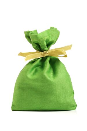 green cloth sack isolated on white background photo