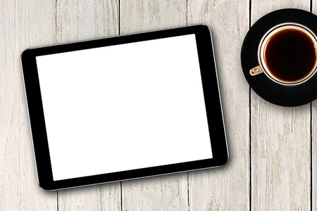 digital tablet and coffee cup on wooden table Stock Photo - 14312374