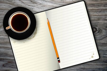 notebook and coffee cup photo