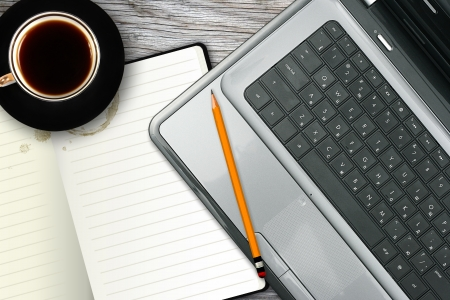 laptop keyboard: workplace with laptop, notebook and coffee cup Stock Photo