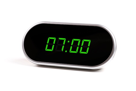 digital alarm clock with green digits photo
