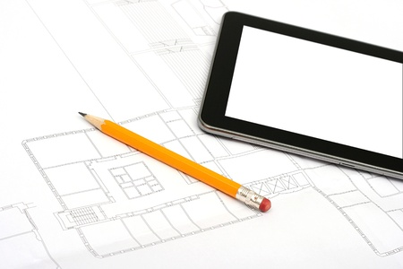 digital tablet and pencil on house plan photo