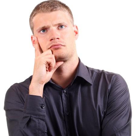 persona confundida: Retrato de hombre joven pensamiento Foto de archivo