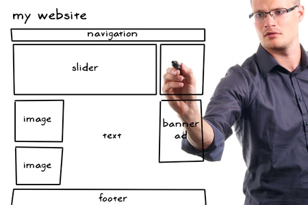 web design company: man drawing website wireframe on the whiteboard Stock Photo