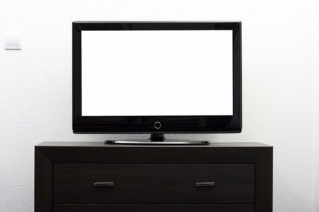 big screen tv: blank tv screen on brown commode against white wall Stock Photo