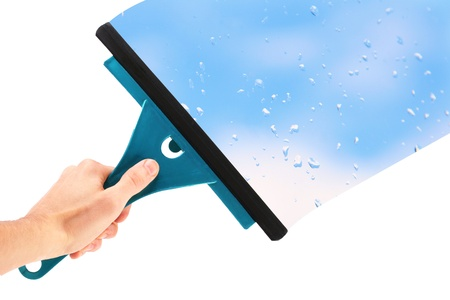 hand with window cleaning tool and blue sky photo