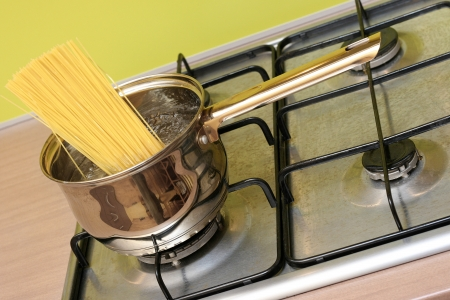 cooking spaghetti pasta in a pot photo