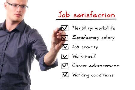 advancement: man writing job satisfaction list on whiteboard