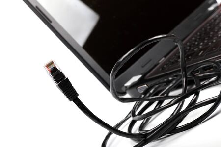 internet cable and laptop on white Stock Photo - 16453676
