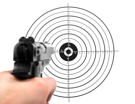 sniper training: hand with gun shooting target Stock Photo