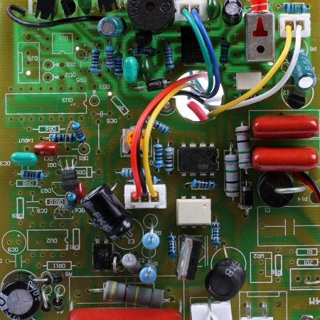 electronic scheme: circuit board with electrical components and wires Stock Photo