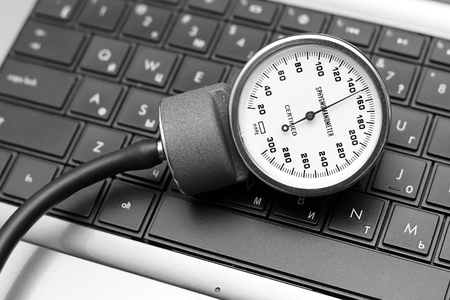 sphygmomanometer: sphygmomanometer on laptop keyboard