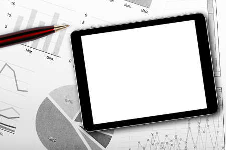 blank digital tablet on business documents photo