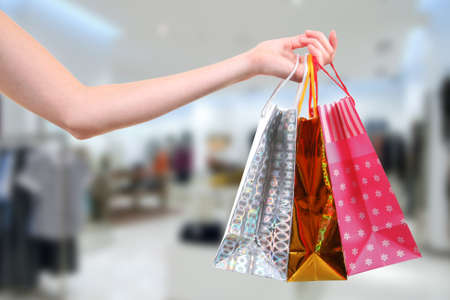 woman with shopping bags in clothes shop Stock Photo - 18019073