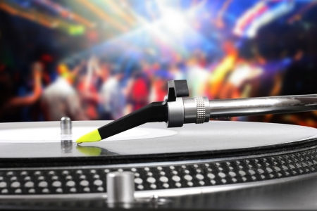 dj turntable with vinyl record in the dance club photo