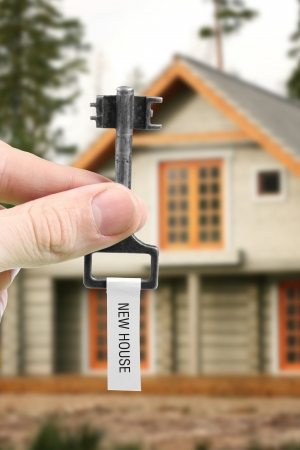 Leasing: hand with key from new house Stock Photo