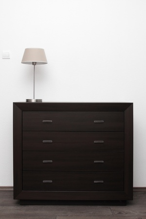commode: brown commode with lamp in bright minimalism interior