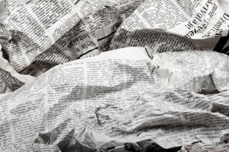 background of old crumpled newspapers photo