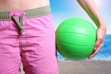 voleibol de playa jugador con la pelota photo
