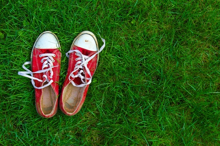 old shoes: sport shoes on grass background Stock Photo
