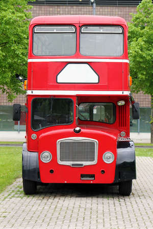 decker: big red double decker bus on the street